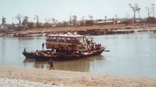 This photo, taken in early 1982, is of JTE being rowed across the river at Narianghat, Nepal (advised by Brian Hedley)